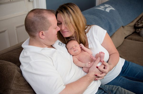 All Occasions Photography Albany NY - Newborn Photography Parents Holding Infant