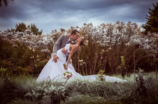 All Occasions Photography Albany NY - Wedding Photography Bride & Groom Kissing in Field