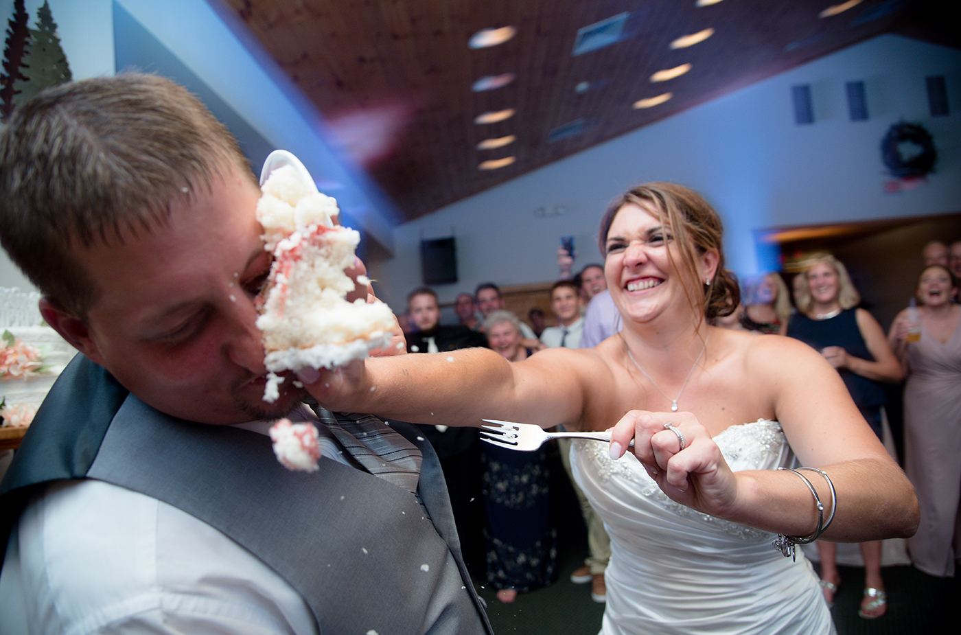 All Occasions Photography Albany NY - Wedding Photography Bride Smashing Cake in Face