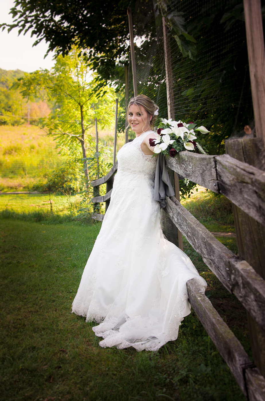 All Occasions Photography Albany NY - Wedding Photography Bride Leaning Against Fence