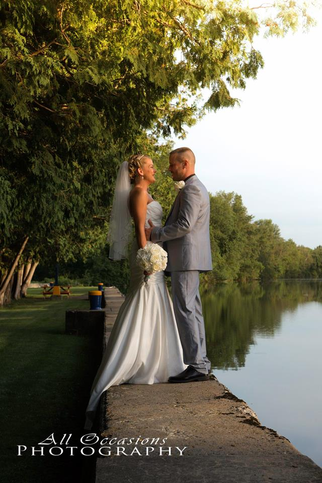 All Occasions Photography Albany NY - Wedding Photography Groom Holding his Bride on dock by lake