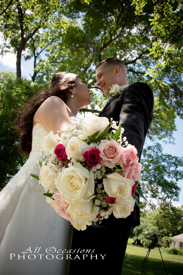 All Occasions Photography Albany NY - Wedding Photography Bride & Groom Smiling at One Another With Floral Bouquet