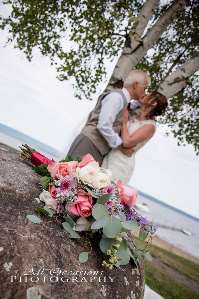 All Occasions Photography Albany NY - Wedding Photography Groom Kissing Bride In Front of Birch Tree by Lake