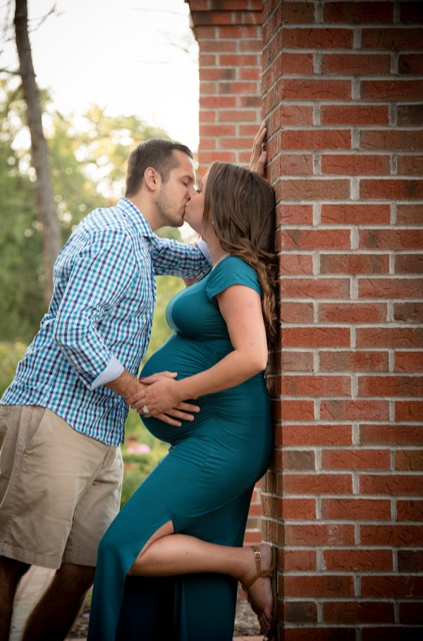 All Occasions Photography Albany NY - Maternity Photography Parents Kissing Against Brick Wall