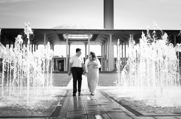 All Occasions Photography Albany NY - Maternity Photography Couple Walking by Fountain
