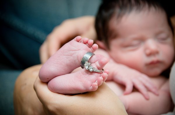 All Occasions Photography Albany NY - Newborn Photography Infant Holding Parent's Wedding Rings on Toes