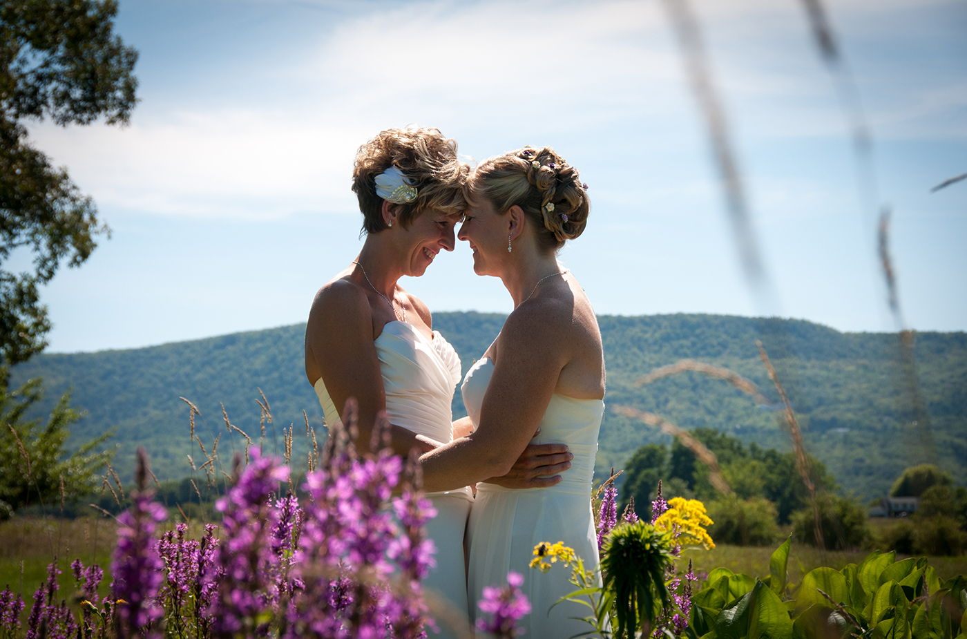 All Occasions Photography Albany NY - Wedding Photography Brides Pressing Foreheads Together with Mountains in Background