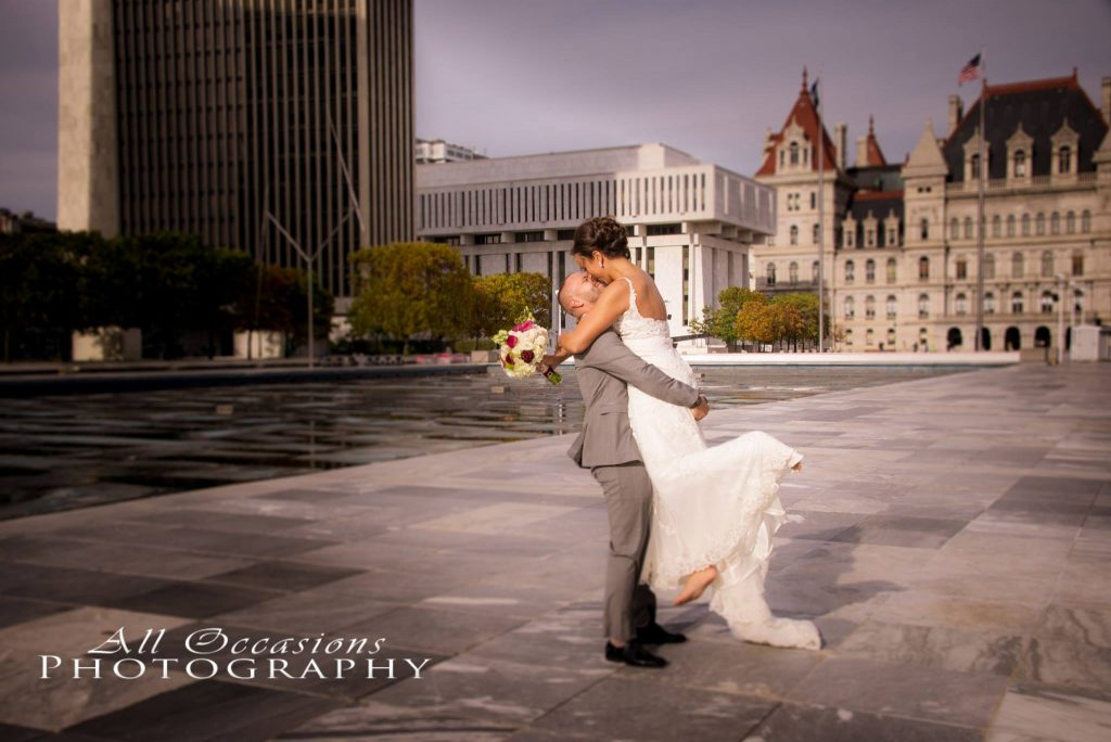 All Occasions Photography Albany NY - Wedding Photography Bride & Groom Kissing at State Capitol