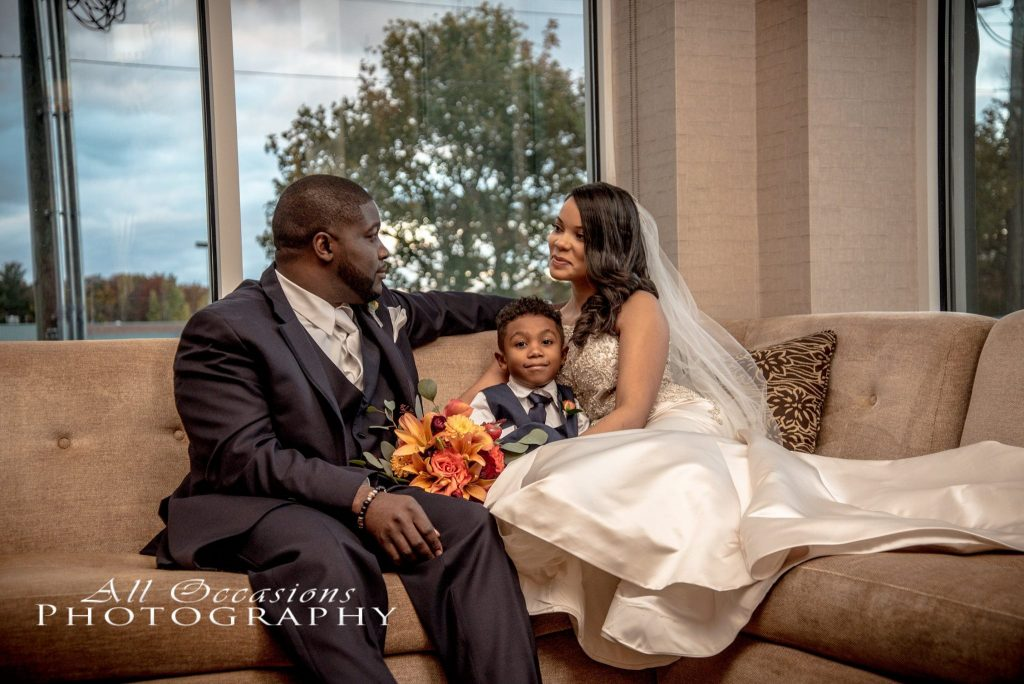 All Occasions Photography Albany NY - Wedding Photography Bride & Groom Sitting on Couch With Son
