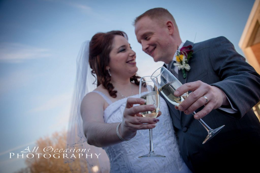 All Occasions Photography Albany NY - Wedding Photography Bride & Groom Clinking Champagne Glasses