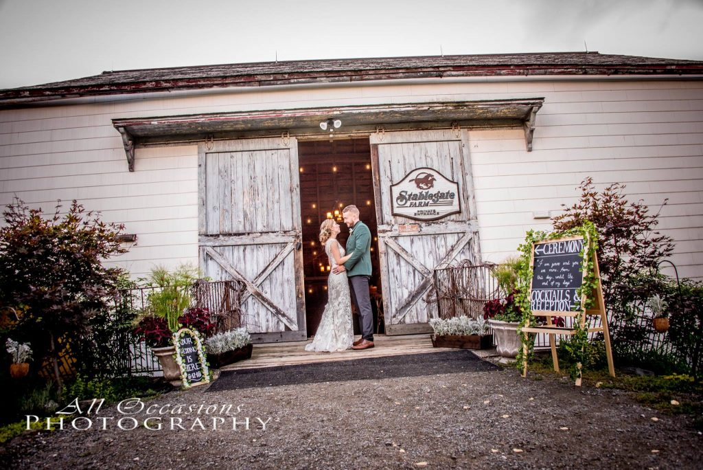 All Occasions Photography Albany NY - Wedding Photography Groom & Bride Embracing in Barn Doorway