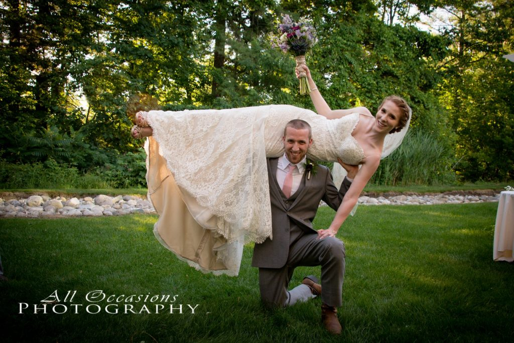 All Occasions Photography Albany NY - Wedding Photography Groom Holding Bride Over Head