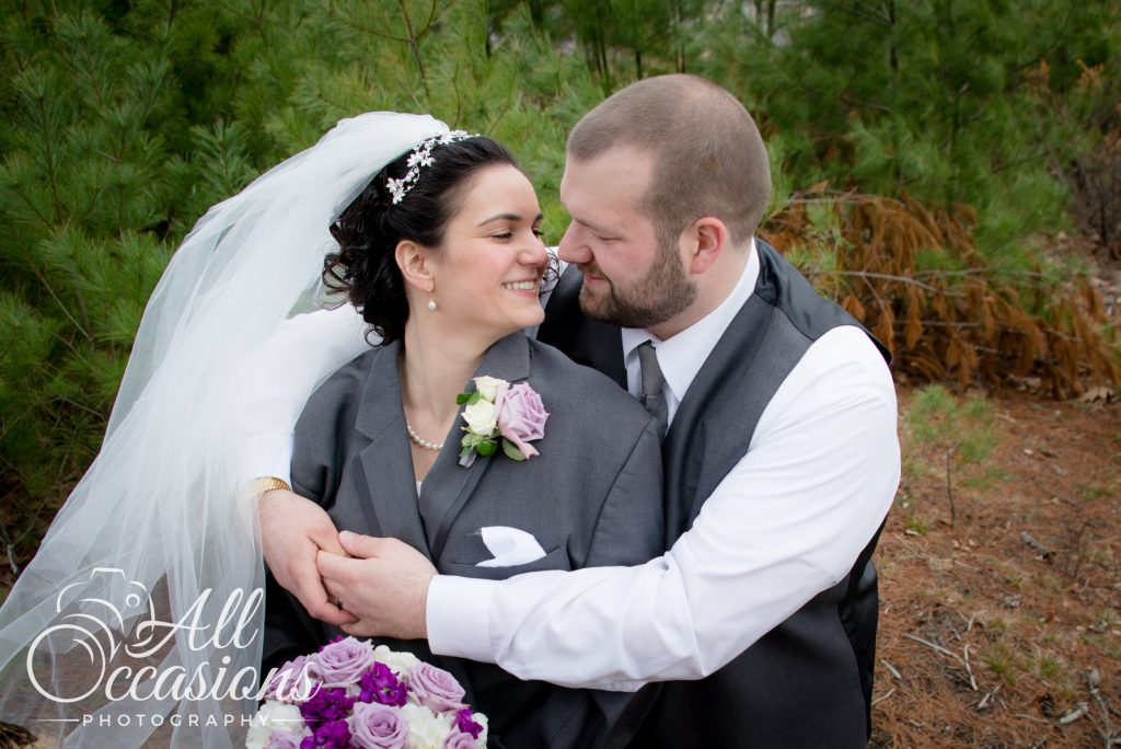 All Occasions Photography Albany NY - Wedding Photography Bride Wrapped in Grooms Coat