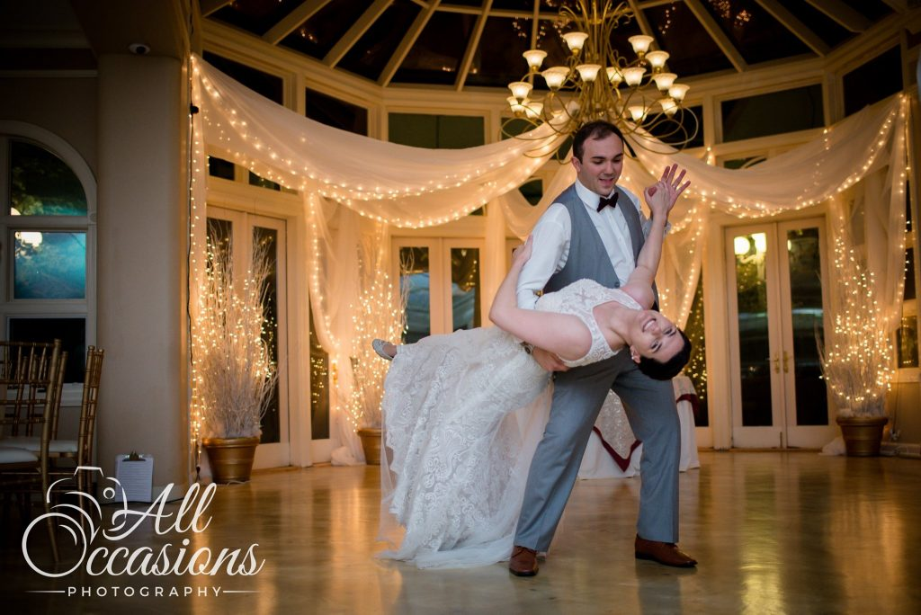 All Occasions Photography Albany NY - Wedding Photography Bride & Groom Dancing Beneath Beautiful Chandelier