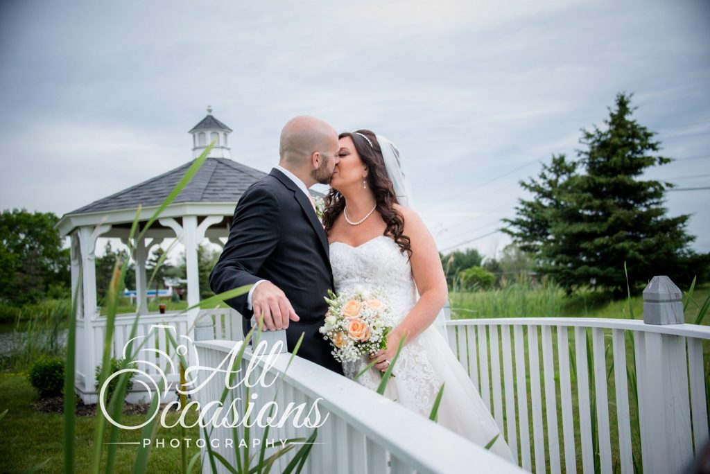 All Occasions Photography Albany NY - Wedding Photography Bride & Groom Kissing Beside Gazebo