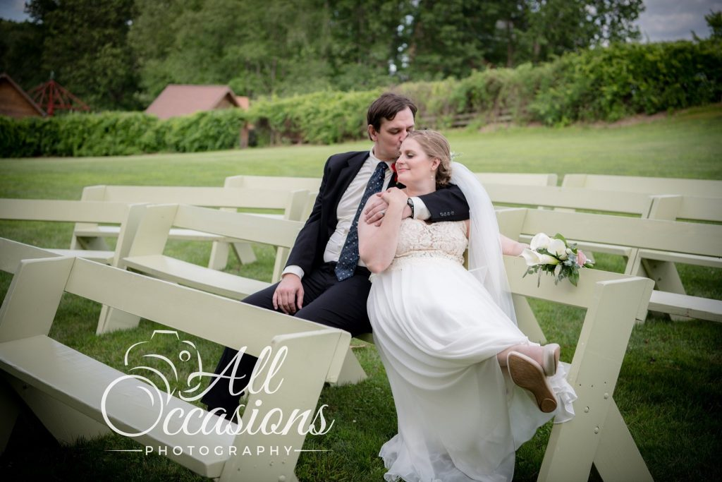 All Occasions Photography Albany NY - Wedding Photography Bride & Groom Kissing on Bench