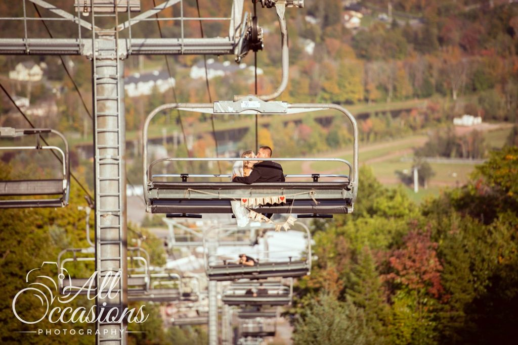 All Occasions Photography Albany NY - Wedding Photography Bride & Groom Kissing on Ski Chair Lift