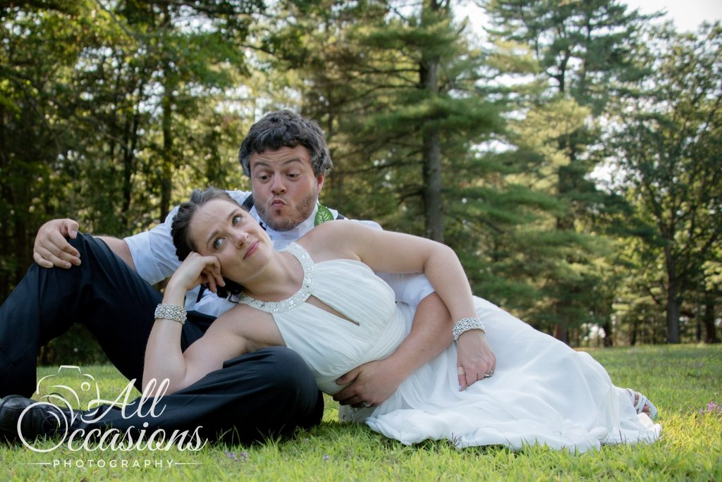 All Occasions Photography Albany NY - Wedding Photography Bride & Groom Lying on Grass Funny